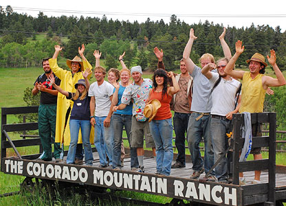 The summer staff at the Colorado Mountain Ranch showing off their spirit on the welcome wagon.